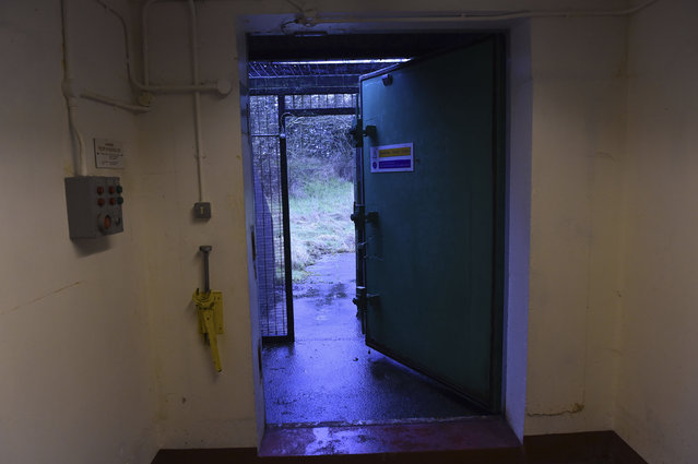 Light comes in from the open blast door at a former Regional Government HQ Nuclear bunker built by the British government during the Cold War which  has come up for sale in Ballymena, Northern Ireland on February 4, 2016. (Photo by Clodagh Kilcoyne/Reuters)