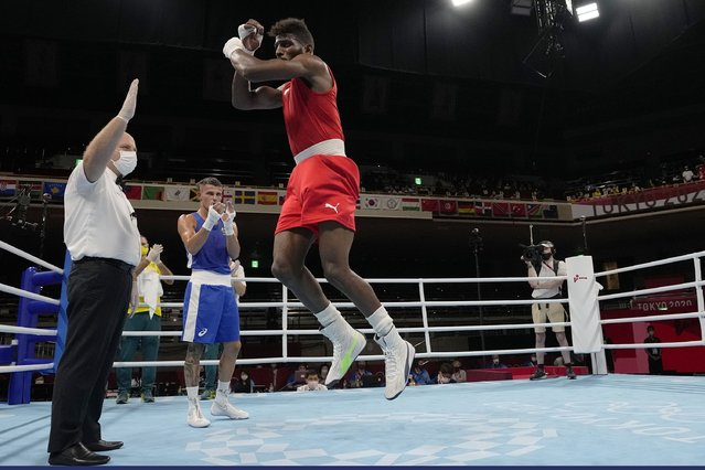Cuba's Andy Cruz, right, leaps in celebration after defeating Australia's Harry Garside, center, during their men's lightweight 63-kg boxing match at the 2020 Summer Olympics, Friday, August 6, 2021, in Tokyo, Japan. (Photo by Themba Hadebe/AP Photo/Pool)