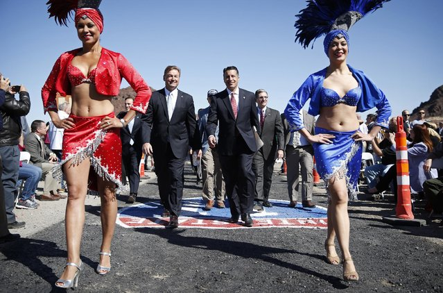 Nevada Gov. Brian Sandoval, center right, and Sen. Dean Heller, R-Nev., center left, attend a groundbreaking ceremony for the Interstate 11 Boulder City bypass project Monday, April 6, 2015, in Boulder City, Nev. (Photo by John Locher/AP Photo)