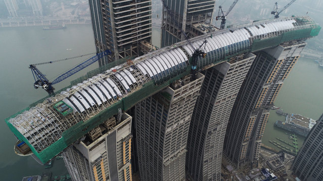 The construction site of a sky corridor above Raffles Square in Chongqing, China on January 15, 2019. (Photo by Wang Quanchao/Xinhua News Agency/Barcroft Images)