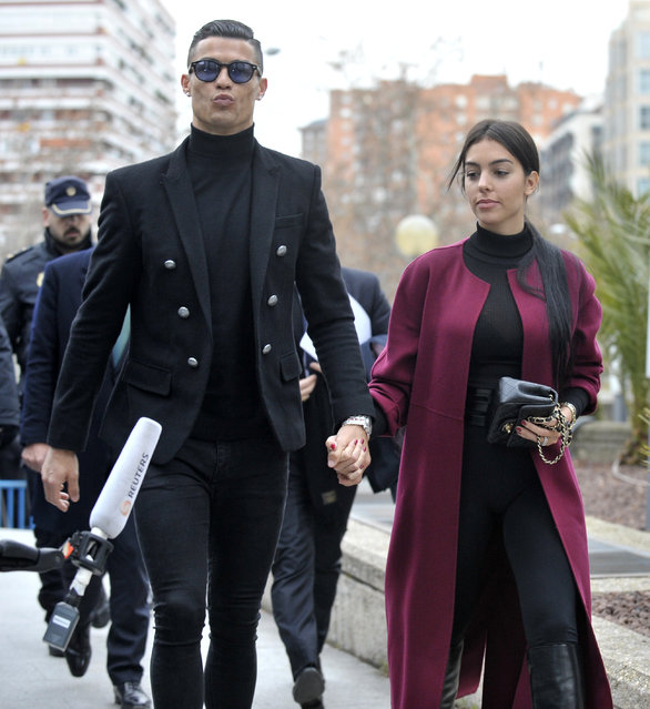 Cristiano Ronaldo and Georgina Rodriguez arrive at the Audiencia Provincial on January 22, 2019 in Madrid, Spain. Cristiano has been called to declare for tax fraud case. (Photo by Europa Press Entertainment/Europa Press via Getty Images)