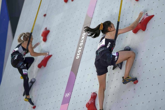 Seo Chae-hyun, of South Korea, competes against Poland's Aleksandra Miroslaw, left, during the speed portion of the women's sport climbing final at the 2020 Summer Olympics, Friday, August 6, 2021, in Tokyo, Japan. (Photo by David Goldman/AP Photo)