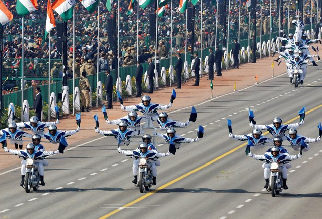 """India's Border Security Force (BSF) """"Daredevils"""" motorcycle riders take part in the Republic Day parade in New Delhi, India, January 26, 2019. (Photo by Altaf Hussain/Reuters)"""