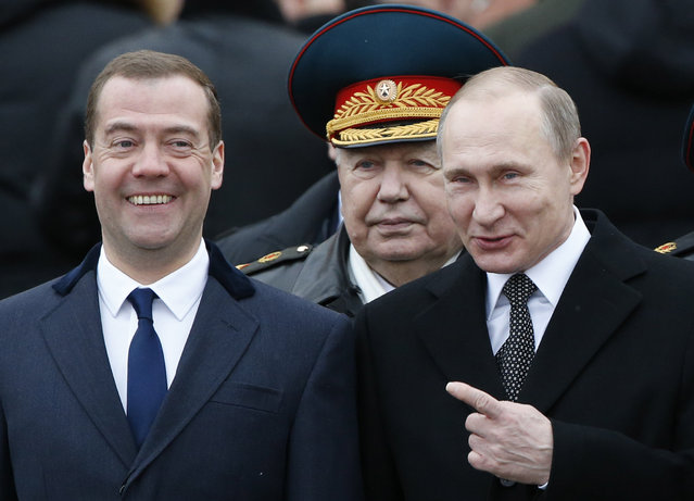 Russian President Vladimir Putin (R) and Prime Minister Dmitry Medvedev (L) attend a wreath laying ceremony to mark the Defender of the Fatherland Day at the Tomb of the Unknown Soldier by the Kremlin wall in central Moscow, Russia, February 23, 2016. (Photo by Sergei Karpukhin/Reuters)