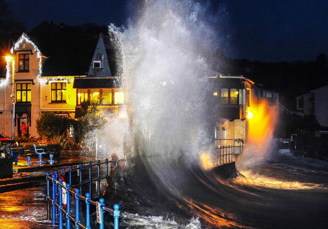 Waves crash over the promenade at high tide in Saundersfoot, in west Wales, on January 3, 2013. The south and west of the country was due to be hit by a combination of heavy rain, strong winds and high spring tides. Britain's Environment Agency said that there could be a threat to life. (Photo by Rebecca Naden/Reuters)
