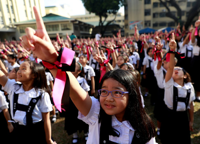 Filipino students dance to take part in the One Billion Rising global campaign to end violence against women and children, during the Valentine's Day celebration at St Scholastica's College in Manila, Philippines, February 14, 2019. (Photo by Eloisa Lopez/Reuters)