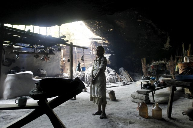 Francisca Gomez poses for a photograph inside her home, a cave where she has been living for the past 50 years, in the mountains on the outskirts of Chusmuy, Honduras April 21, 2015. The 75-year old widow receives help from neighbors and friends and she makes a little money by selling wood she collects, according to a local newspaper. (Photo by Jorge Cabrera/Reuters)