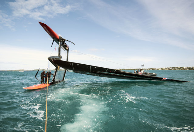 This photo provided by Oracle Team USA shows two-time defending America's Cup champion Oracle Team USA after they capsized a 45-foot catamaran while training in Bermuda on Wednesday, March 2, 2016. Skipper Jimmy Spithill said there were no injuries to the six sailors aboard and only slight damage to some electronics when the boat rolled over onto its port hull, the tip of its wing sail resting on the water. The boat was quickly righted and sailed back to the dock. (Photo by Sam Greenfield/Oracle Team USA via AP Photo)