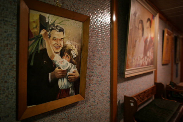 A painting that depicts former Romanian communist dictator Nicolae Ceausescu hangs on a wall in one of the hallways that lead to the bunker of Romania's former communist dictator Nicolae Ceausescu in Bucharest, Romania, January 25, 2017. (Photo by Octav Ganea/Reuters/Inquam Photos)