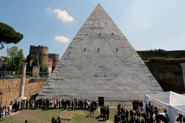 A view of the Piramide Cestia (Pyramid of Cestius) monument after restyling opening in Rome, Italy, 20 April 2015. The restoration works were sponsorized by Japan manager Yuzo Yagi who participated in the opening on 20 April. The pyramid was erected as tomb for Roman member of magistrate Gaius Cestius about 18 BC-12 BC.  (Photo by Fabio Campana/EPA)