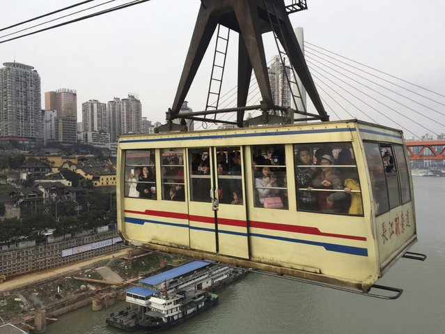People travel in a cable car in Chongqing, China, January 24, 2016. (Photo by Sue-Ling Wong/Reuters)