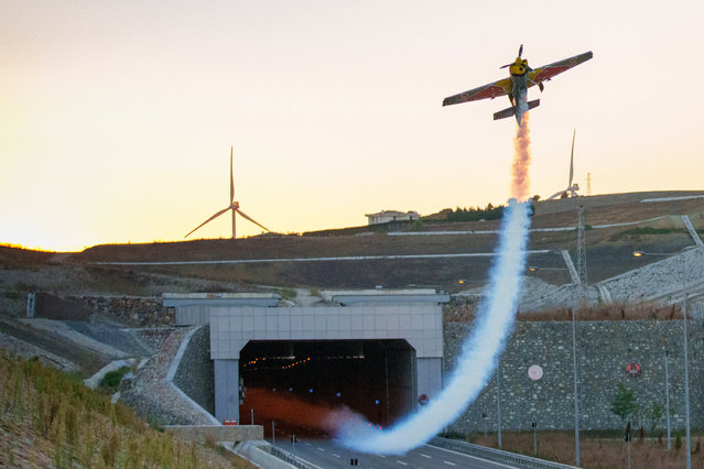 A handout photo made available by the Red Bull Press Office shows Italian pilot Dario Costa in action as he flying through the Catalca Tunnel in Istanbul, Turkey, 04 September 2021. Costa set a new world record for the longest tunnel flown through with an aeroplane marking 1,610 metres. (Photo by Nuri Yilmazer Handout/Rex Features/Shutterstock)
