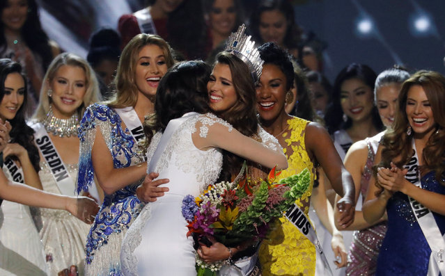 Contestants congratulate Miss France Iris Mittenaere after she was declared winner in the Miss Universe beauty pageant at the Mall of Asia Arena, in Pasay, Metro Manila, Philippines January 30, 2017. (Photo by Erik De Castro/Reuters)