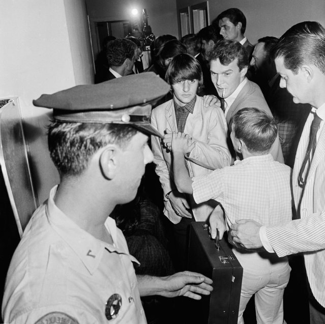 A New Orleans youngster achieved the ultimate on Wednesday night as he scooted under police barricades to touch Ringo Starr, famed drummer of the Beatles. The famed English born group performed before some 13,000 howling teenagers at New Orleans City Park on Wednesday, September 17, 1964 in New Orleans. (Photo by AP Photo)
