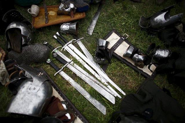Equipment of fighters lie on the ground during the Medieval Combat World Championship at Malbork Castle, northern Poland, April 30, 2015. (Photo by Kacper Pempel/Reuters)