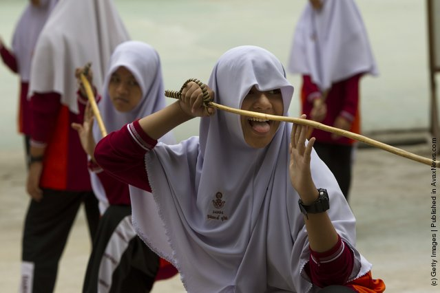 Islamic female students practice the ancient Thai art of Krabi Krabong taught as a sport at the Darunsat Wittaya school