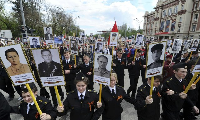 People hold pictures of World War Two soldiers as they take part in the Immortal Regiment march in Rostov-on-Don, Russia, May 9, 2015. (Photo by Reuters/Host Photo Agency/RIA Novosti)