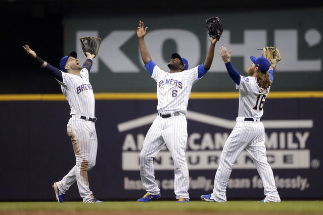Milwaukee Brewers' Lorenzo Cain (6), Ben Gamel (16), and Ryan Braun celebrate the team's 3-1 win over the New York Mets in a baseball game Friday, May 3, 2019, in Milwaukee. (Photo by Aaron Gash/AP Photo)