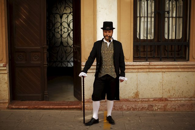 "Jose Manuel Sierra, 32, dressed as a bourgeois, poses for a photo as he participates in the third edition of ""Ronda Romantica"" (Romantic Ronda) in Ronda, southern Spain, May 16, 2015. (Photo by Jon Nazca/Reuters)"