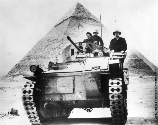 1939: A British tank set against a background of one of the Egyptian pyramids, during World War II