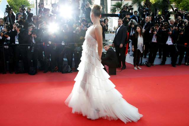 """US model Bella Hadid poses as she arrives for the screening of the film """"Rocketman"""" at the 72nd edition of the Cannes Film Festival in Cannes, southern France, on May 16, 2019. (Photo by Jean-Paul Pelissier/Reuters)"""