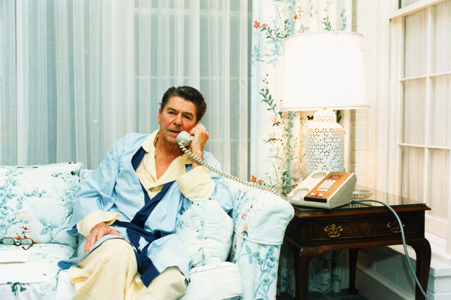 President Ronald Reagan telephones Vice President Bush at 5:58 a.m. regarding the Grenada situation from the White House, Washington, DC on October 22, 1983. Ronald Wilson Reagan was the 40th U.S. President serving from 1981 – 1989. (Photo by Corbis/Bettmann)