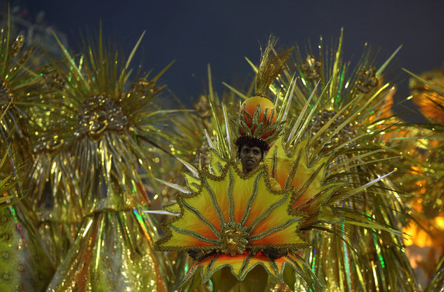 A reveller from Sao Clemente samba school performs during the second night of the carnival parade at the Sambadrome in Rio de Janeiro, Brazil February 27, 2017. (Photo by Pilar Olivares/Reuters)