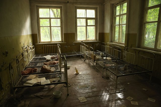 The 30th anniversary of the meltdown at the Chernobyl nuclear plant that caused large amounts of radioactive particles to be released into the air will be commemorated on April 26, 2016. Photojournalist Sean Gallup returned to the area to document the lasting effects of the world's worst nuclear power plant accident. Pictured, children's beds are seen in an abandoned kindergarten in Kopachi village located inside the Chernobyl exclusion zone, Sept. 29, 2015, near Chernobyl, Ukraine. (Photo by Sean Gallup/Getty Images)