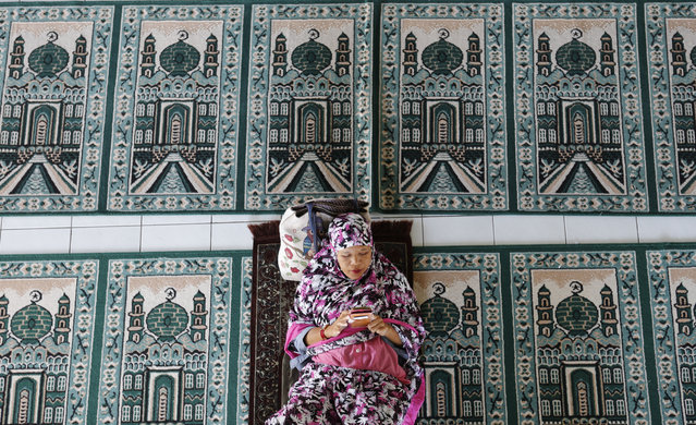 In this May 6, 2019, photo, a woman rests at a mosque during the first day of the holy fasting month of Ramadan in Bali, Indonesia. Muslims around the world marked the start of Ramadan on Monday, a month of intense prayer, dawn-to-dusk fasting and nightly feasts. (Photo by Firdia Lisnawati/AP Photo)