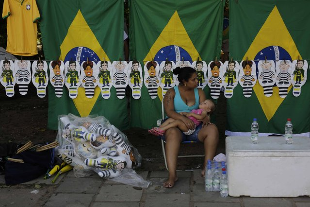 A vendor sells Brazilian flags and dolls portraying former President Luiz Inacio Lula da Silva President Dilma Rousseff during a pro-impeachment demonstration in Porto Alegre, Brazil, April 17, 2016. (Photo by Lunae Parracho/Reuters)