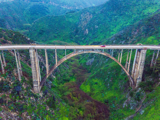 The drama of Bixby Creeks famous deck arch bridge has inspired countless car commercials. (Photo by Chase Guttman/Caters News)