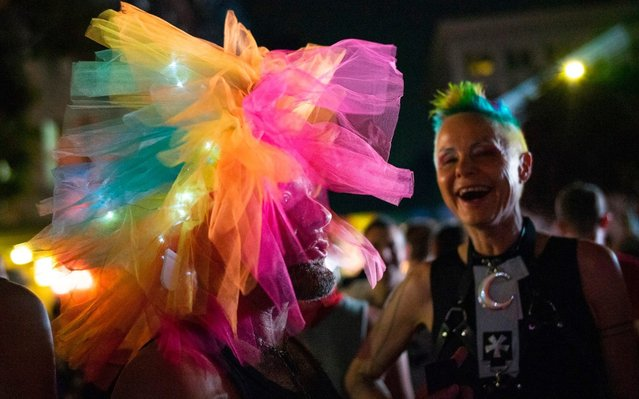 A man wears a rainbow tutu as people attend the Stonewall 50 Pride Rally, Friday, June 28, 2019, in New York. Thousands of people have converged on New York City's Stonewall Inn for the 50th anniversary of the rebellion that catalyzed a movement for LGBTQ liberation. (Photo by Eduardo Munoz Alvarez/AP Photo)