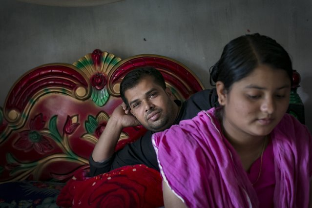 Meghla sits with her husband Liton on March 7, 2017 in Khulna division, Bangladesh. (Photo by Allison Joyce/Getty Images)