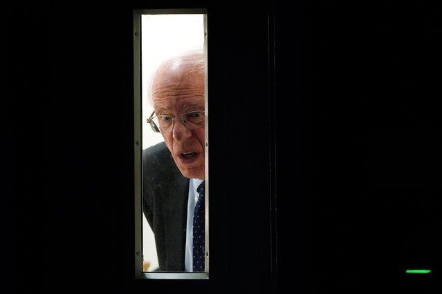 Democratic 2020 U.S. presidential candidate Senator Bernie Sanders peers out of a doorway before taking the stage at the Presidential Candidate Forum hosted by NALEO at Telemundo Center in Miami, Florida, U.S., June 21, 2019. (Photo by Carlo Allegri/Reuters)