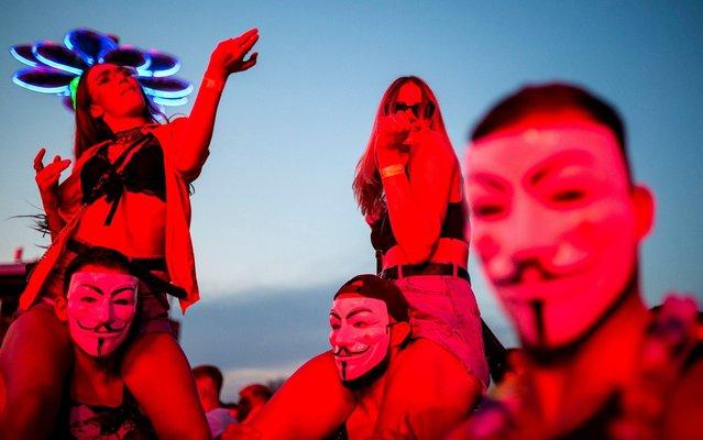 Revellers enjoy themselves at the Balaton Sound music festival at Lake Balaton in Zamardi, southwestern Hungary, 06 July 2019 (issued 07 July 2019). (Photo by Boglarka Bodnar/EPA/EFE/Rex Features/Shutterstock)