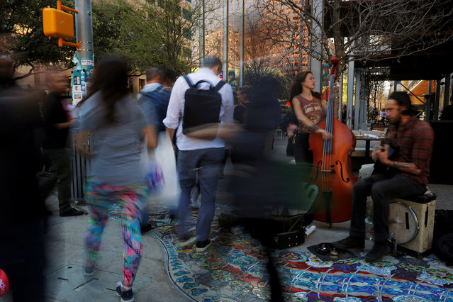 Outlaw Ritual performs on a street corner during the South by Southwest (SXSW) Music Film Interactive Festival 2017 in Austin, Texas, U.S., March 13, 2017. (Photo by Brian Snyder/Reuters)