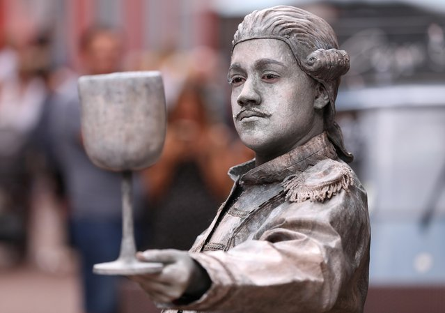 "An artist called ""Le Sommelier"" takes part in the festival ""Statues en Marche"" in Marche-en-Famenne, Belgium, July 20, 2019. (Photo by Yves Herman/Reuters)"