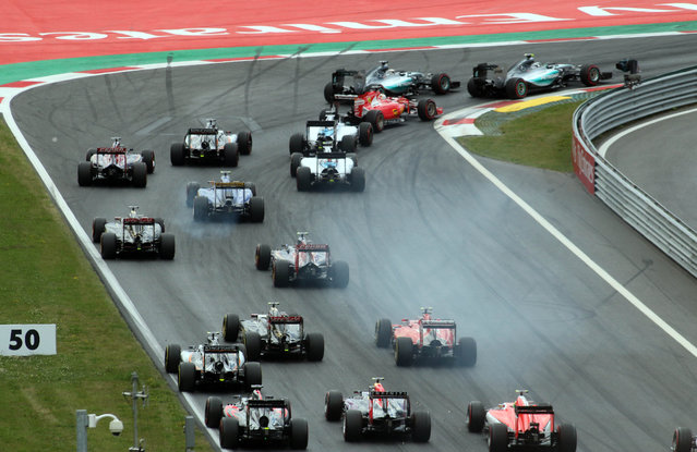 Drivers steer their cars at start of the Austrian Formula One Grand Prix race in Spielberg, southern Austria, Sunday, June 21, 2015. (AP Photo/Ronald Zak)
