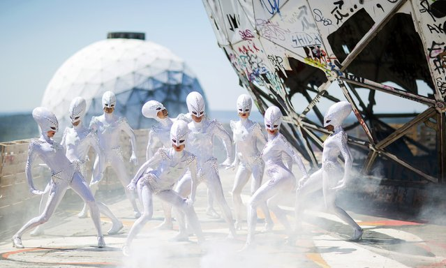 """Dancers of the Friedrichstadt-Palast from the show """"THE WYLD"""" pose during a promotional photocall at a former National Security Agency (NSA) listening station at the Teufelsberg (Devil's Mountain) in Berlin, Germany, July 2, 2015. (Photo by Hannibal Hanschke/Reuters)"""