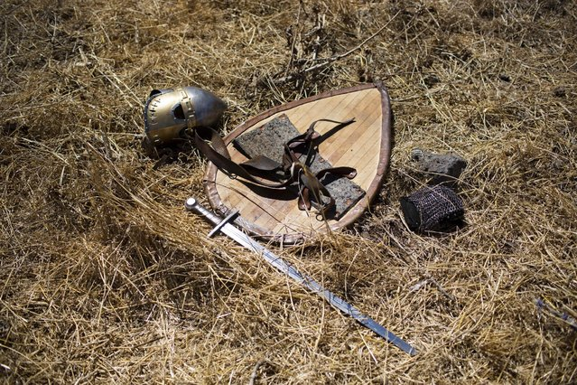 In this Saturday, July 4, 2015 photo, knight gear is laid on the ground after the reenactment of the Battle of Hattin in Horns of Hattin, northern Israel. (Photo by Oded Balilty/AP Photo)
