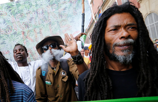 A protester smokes marijuana during a march calling for the legalisation on cannabis in Cape Town, South Africa, May 7, 2016. (Photo by Mike Hutchings/Reuters)