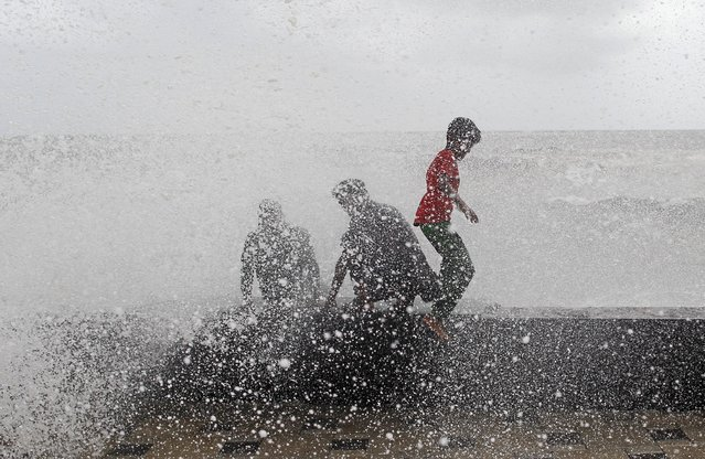 People are drenched when a large wave crashes during high tide at a sea front in Mumbai, India, July 6, 2015. (Photo by Danish Siddiqui/Reuters)