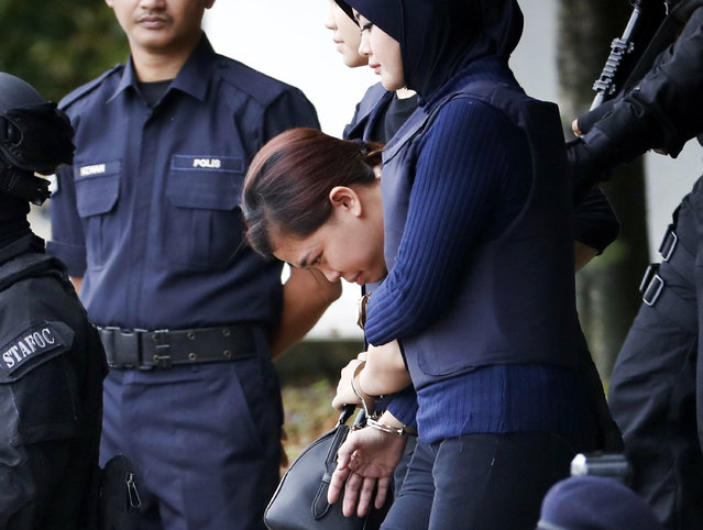 Indonesian suspect Siti Aisyah, center, arrested in the death of Kim Jong Nam, is escorted by police officers as she leaves at a court house in Sepang, Malaysia, Thursday, April 13, 2017. (Photo by Vincent Thian/AP Photo)