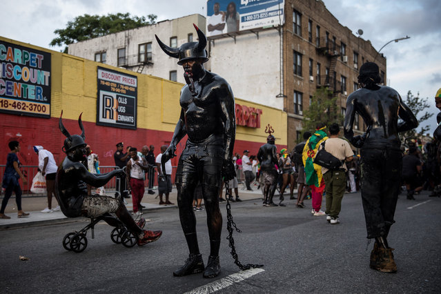 People participate in the annual J'ouvert, celebration which precedes the annual West Indian Day Parade, in Brooklyn, New York, USA, 02 September 2019. The annual J'ouvert event is linked to a tradition found in many Caribbean nations and is now related to Carnival celebrations. (Photo by Michael Nagle/EPA/EFE)