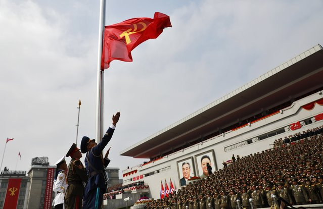 "North Korean soldiers hoist the Communist Party flag during a parade for the ""Day of the Sun"" festival on Kim Il Sung Square in Pyongyang, North Korea, 15 April 2017. (Photo by How Hwee Young/EPA)"