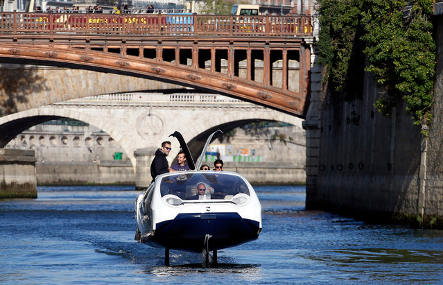 The SeaBubbles water taxi glides above the surface of the Seine River in front of Notre-Dame during a test by the SeaBubbles company on September 19, 2019 in Paris, France. The electric boat of the Franco-Swedish company SeaBubbles and designed by Alain Thébault, gives the impression of flying over the water, and could act as a water taxi in Paris, and in other large cities from next spring. (Photo by Chesnot/Getty Images)