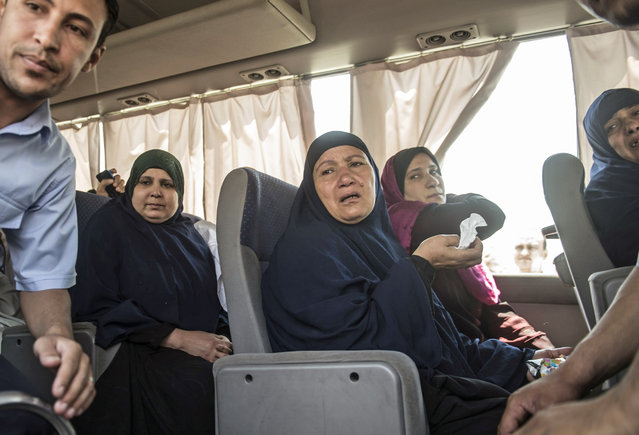 Family members of passengers who were flying aboard an EgyptAir plane that vanished from radar en route from Paris to Cairo overnight are transported by bus to a gathering point at Cairo airport on May 19, 2016. (Photo by Khaled Desouki/AFP Photo)