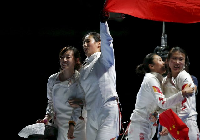China's Yujie Sun (L) celebrates with teammates their victory over team Romania in the women's team epee final at the World Fencing Championships in Moscow, Russia, July 18, 2015. (Photo by Maxim Zmeyev/Reuters)
