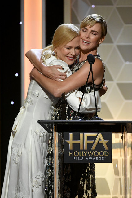 (L-R) Nicole Kidman presents Charlize Theron with the Hollywood Career Achievement Award onstage during the 23rd Annual Hollywood Film Awards at The Beverly Hilton Hotel on November 03, 2019 in Beverly Hills, California. (Photo by Kevin Winter/Getty Images for HFA)