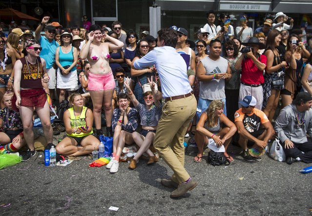 Justin Trudeau, leader of the Liberal Party of Canada, interacts with people during the 37th Annual Vancouver Pride Parade in Vancouver, British Columbia August 2, 2015. (Photo by Ben Nelms/Reuters)